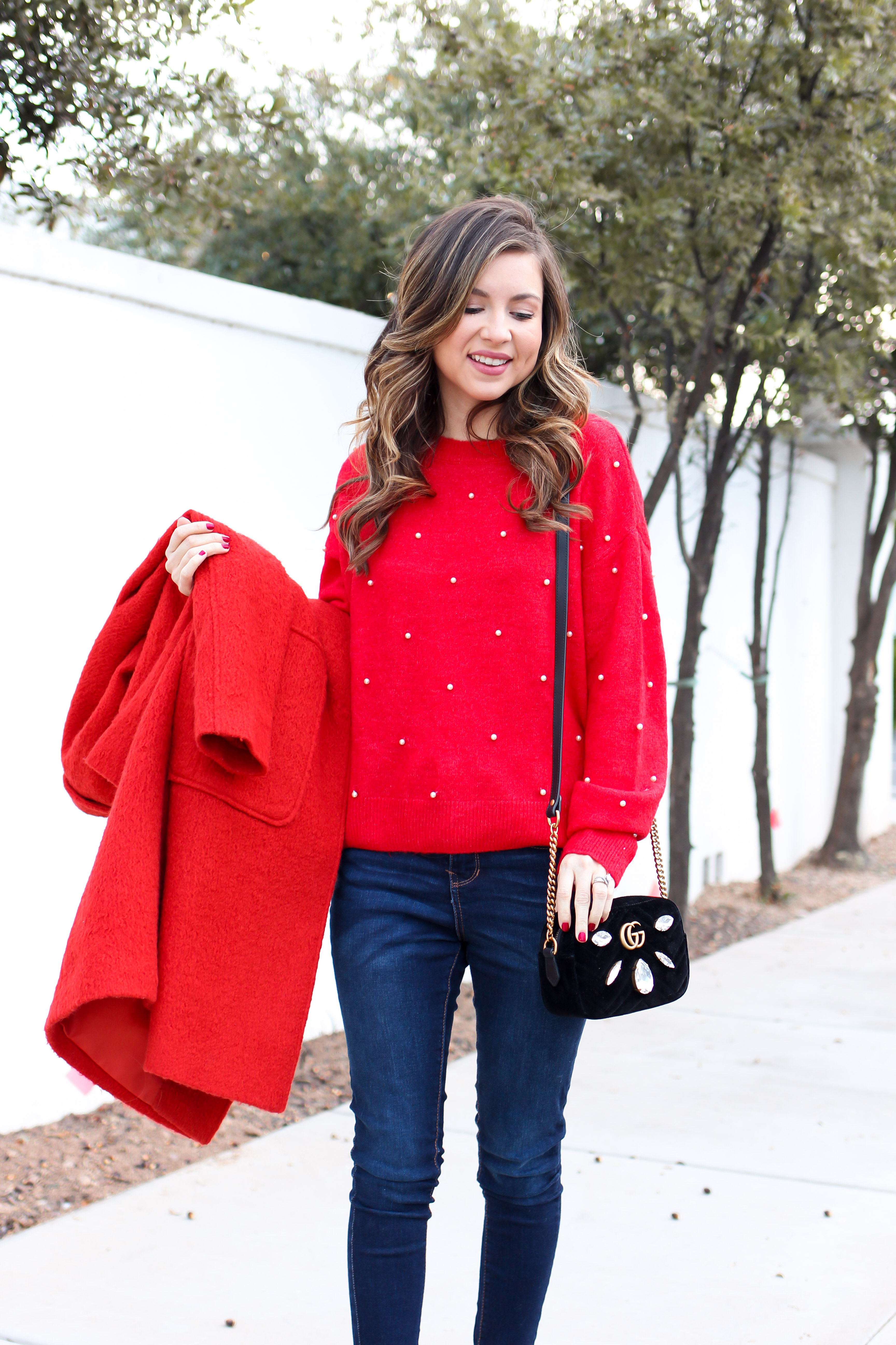 fashion blogger wearing red coat - with red pearl sweater - casual but statement way to wear red