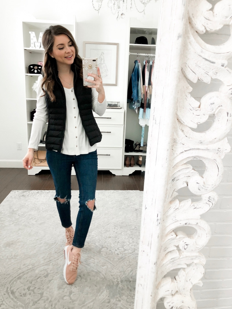 how to wear pink sneakers with jeans and a puffer vest