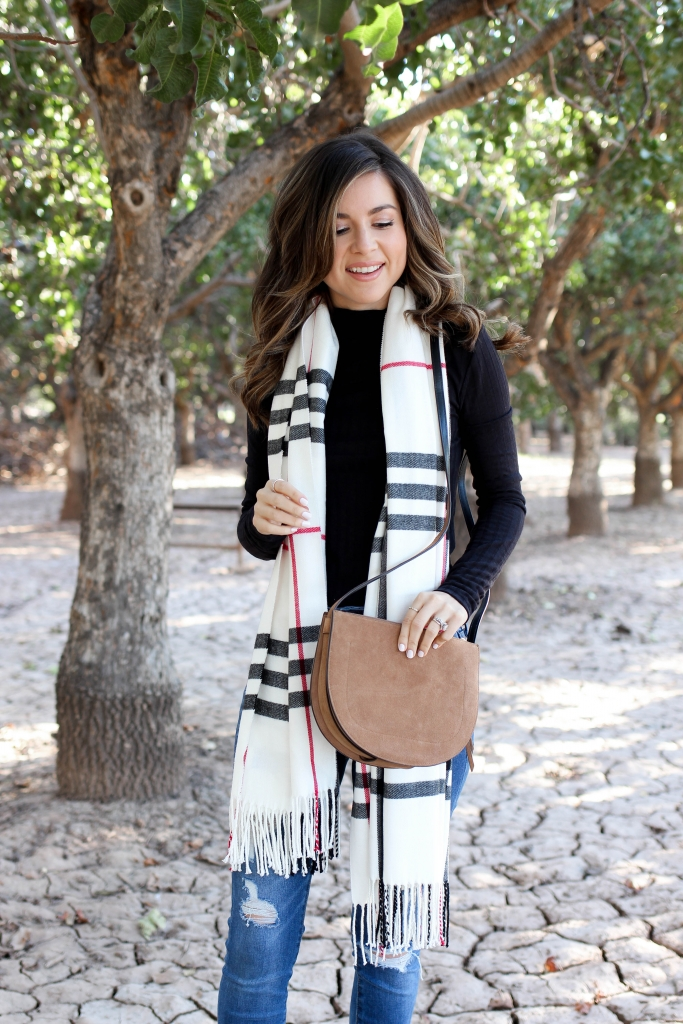 fashion blogger shares 7 turtlenecks to shop under $50 to wear for winter