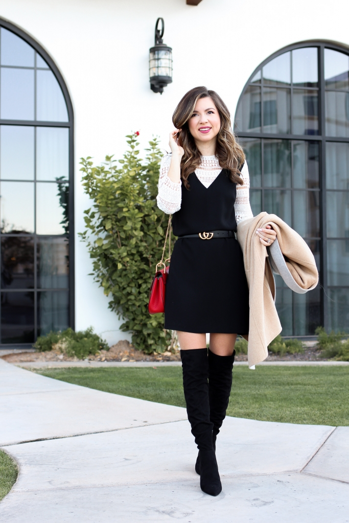 chic black dress with belt and black over the knee boots