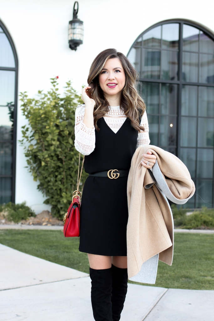 blogger wears lace shift dress with over the knee boots a peacoat and gucci belt