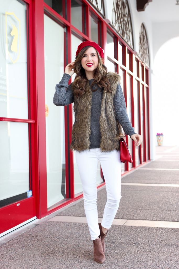 winter outfit ideas with faux fur vests and white jeans