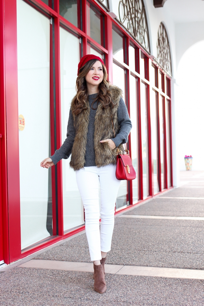 blogger wearing faux fur vest with winter outfit