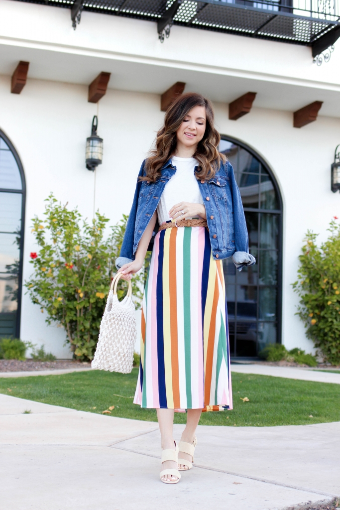 Denim jacket and striped midi skirt