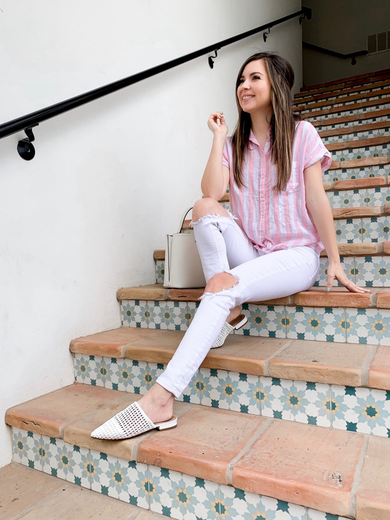 white jean outfit with woven mules