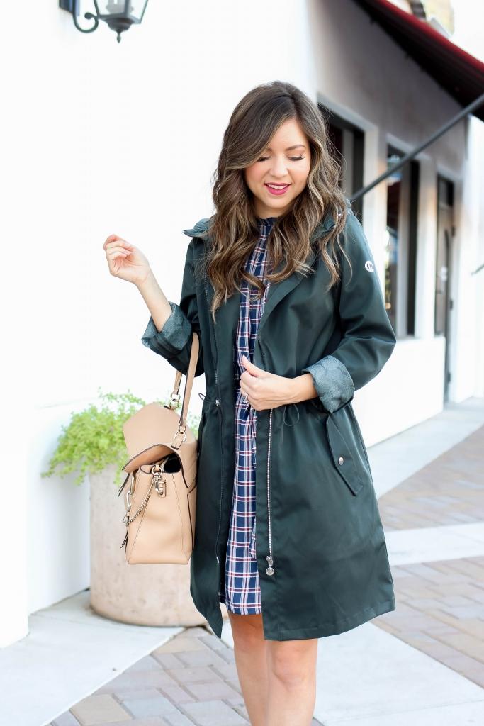 green raincoat and plaid dress