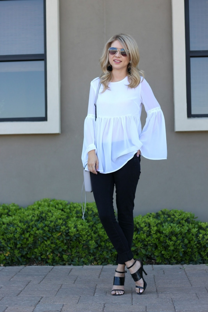 bell-sleeve blouse, black jeans , spring outfit
