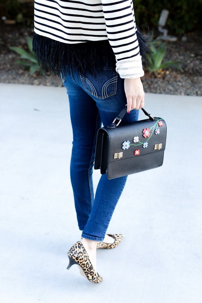denim outfit - casual style - spring street style - feather hem top - leopard heels
