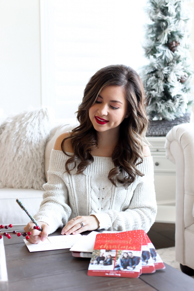 brunette lifestyle blogger sharing how to get 50% off holiday cards from mixbook