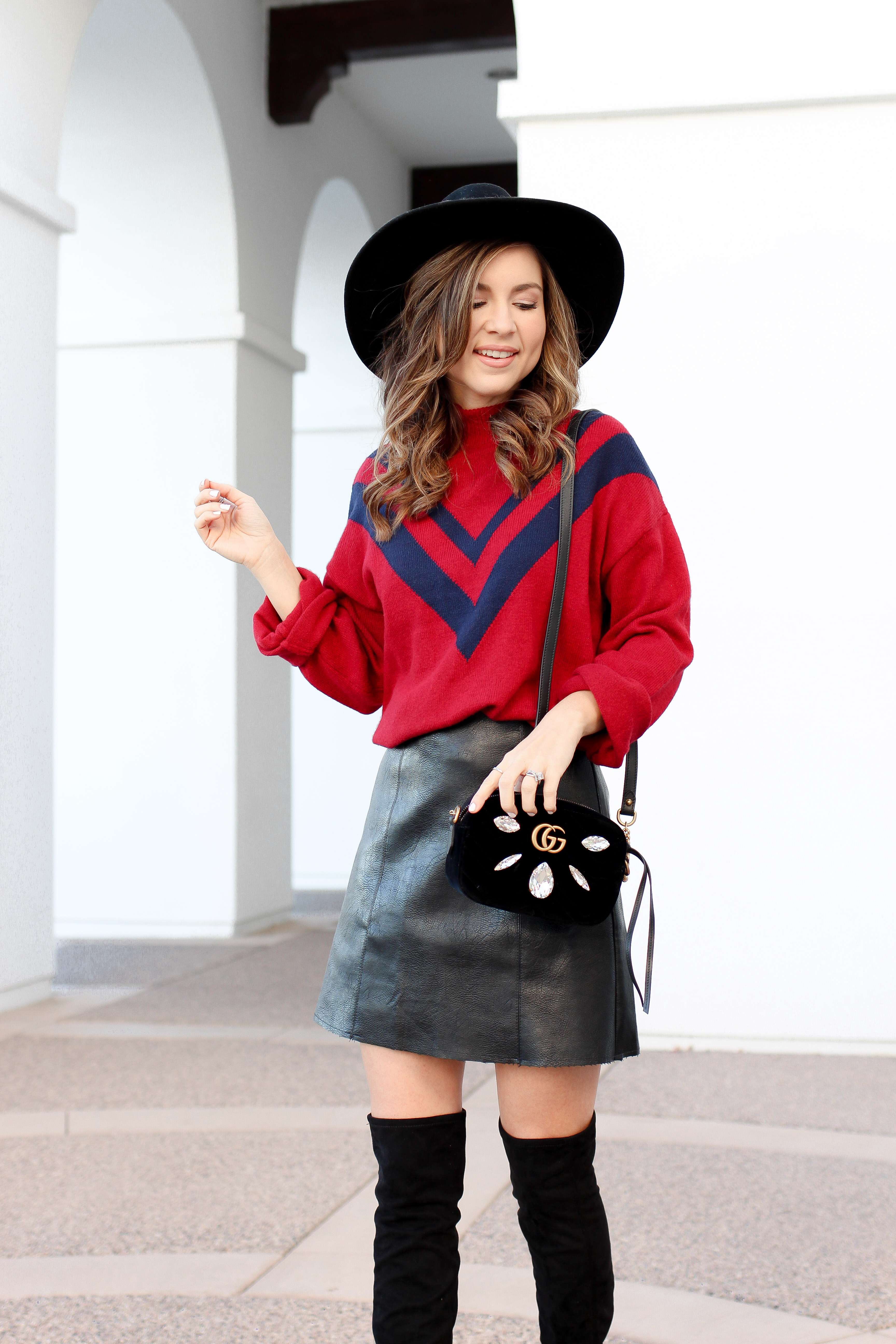 how to wear over the knee boots - faux leather skirt outfit - red sweater - holiday skirt outfit