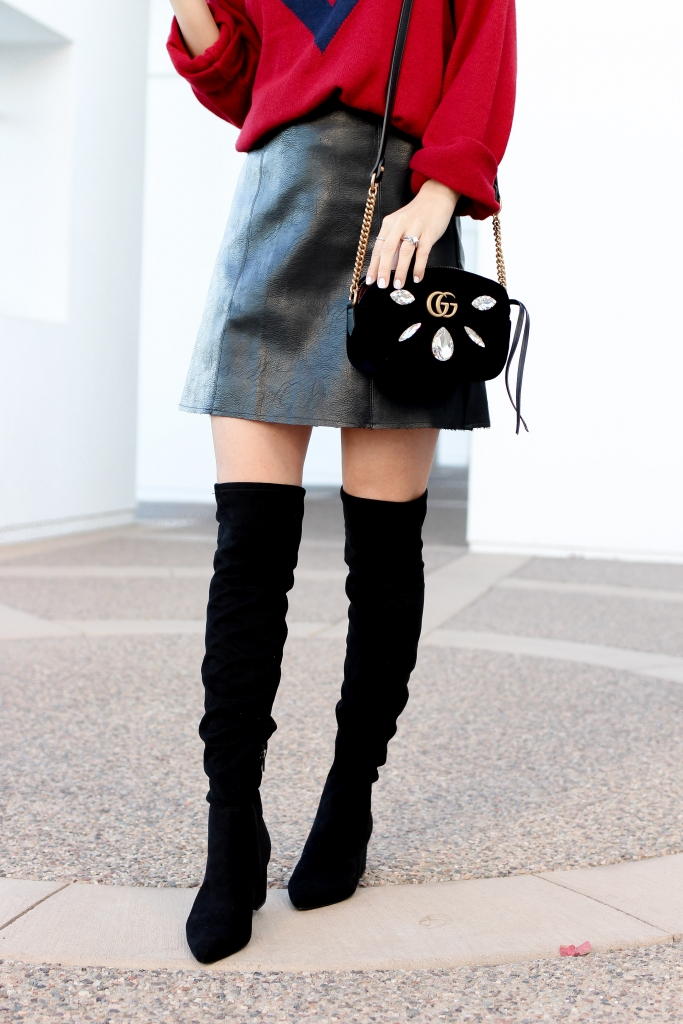 how to wear over the knee boots - faux leather skirt outfit - red sweater - holiday outfit - gucci bag