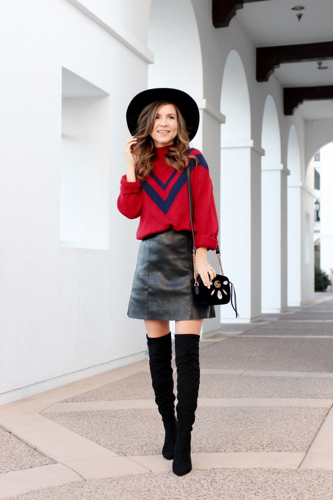 how to wear over the knee boots - faux leather skirt outfit - red sweater - holiday outfit