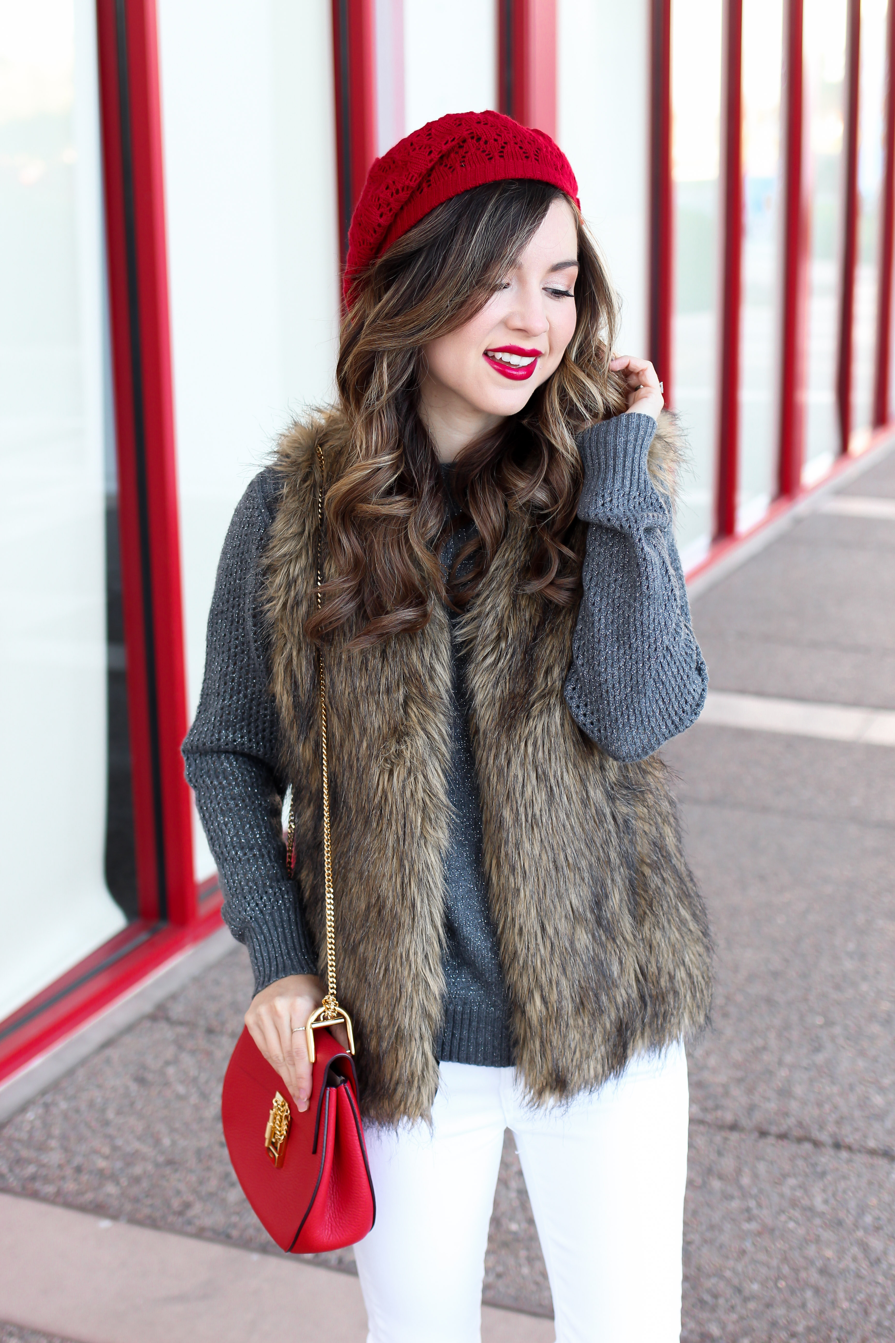 how to wear a faux fur vest with jeans and knit sweater